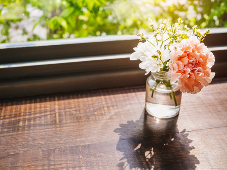 Flowers carnation decoration glass on wooden table Home decoration