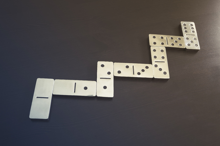 business game: Domino pieces Game on black background Business concept