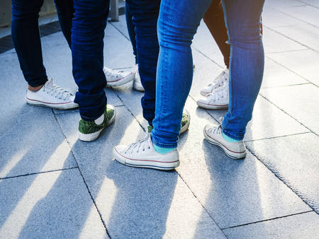 Teenager street wear whit Jeans pant and sneakers Hipster lifestyle