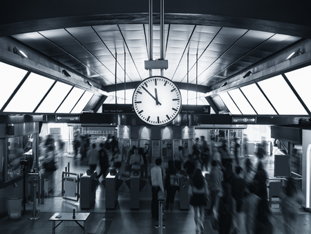 Station Clock display in train station Blur people crowd Travel transportation Banco de Imagens - 77964892