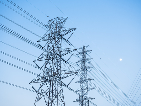 power cables: High voltage post Tower sky background Stock Photo