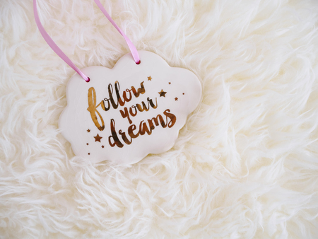 Follow your Dream sign Cloud on White furry Fantasy background Inspiration Quote
