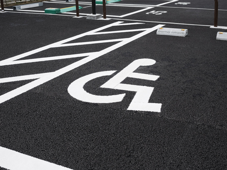 Disability wheelchair sign Priority Car park outdoor Parking lot perspective