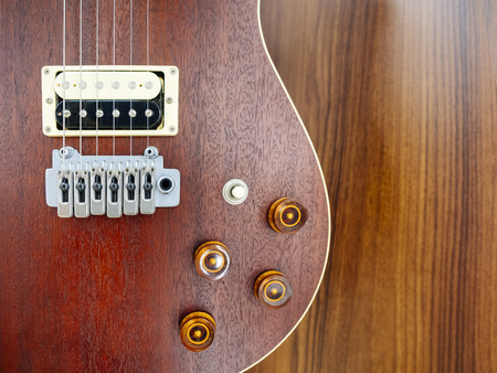 Electric Guitar close up on wooden background Music lifestyle background