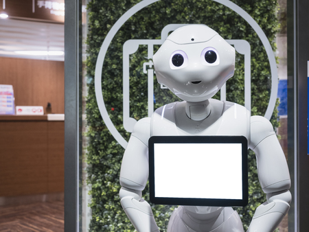 KYOTO, JAPAN - APR 14, 2017 : Pepper Robot Assistant with Information screen at Kyoto station Tourism Japan Редакционное