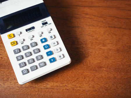Calculator on wooden table Financial Business background Stock Photo