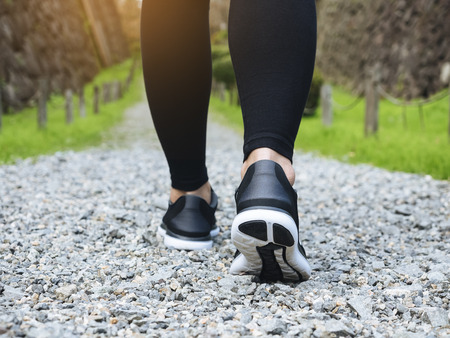 Trail walking woman legs with sport shoe Forest Park outdoor Travel adventure