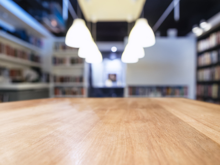 Table top wooden counter Blur Bookshelf Book shop Library Stock Photo
