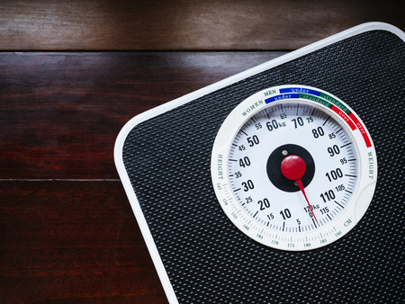 Weight Scale on wooden background