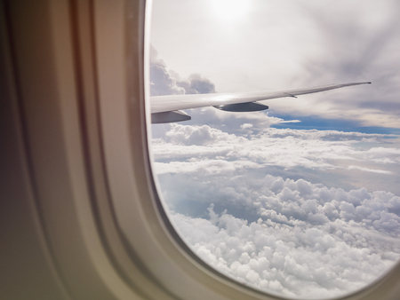 Airplane window view cloud sky aircraft wing