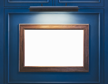 Mock up Blank Wooden Frame on blue wall with spot light Interior decoration 스톡 콘텐츠