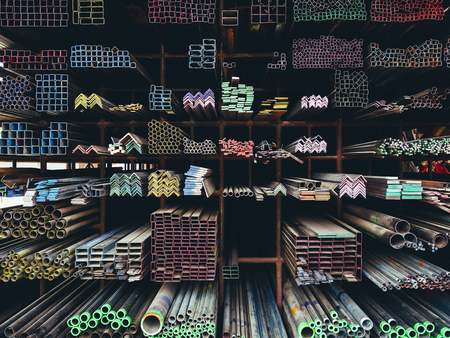 Steel Pipes Industry Construction stacked in warehouse Banco de Imagens