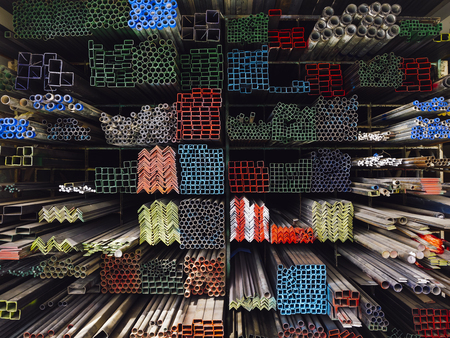 Steel Pipes Industry Construction stacked in warehouse Imagens
