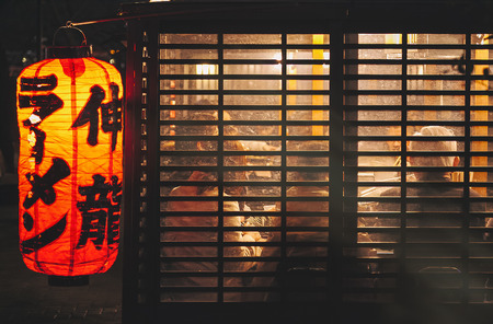 FUKUOKA, JAPAN - MAR 3, 2012 : Yatai Fukuokas open air food stands Ramen shop with crowd people city nightlife Editorial