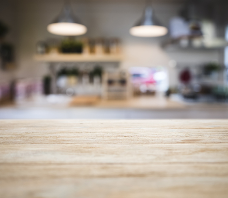 Table top wooden counter Blur Kitchen pantry with shelf and lighting background  스톡 콘텐츠