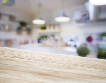 Table top wooden counter Blur Kitchen pantry with shelf and lighting background  Zdjęcie Seryjne