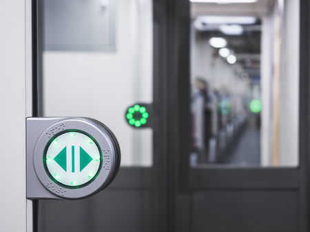 Automatic Gate with green arrow sign in Train Transportation Travel concept Stock Photo