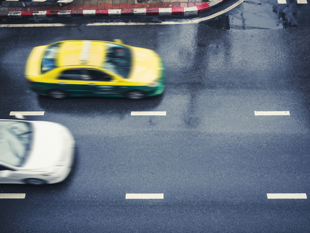 Taxi Cap car moving on street urban city transportation top view Imagens