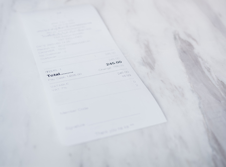 Receipt on a white table shop payment receipt