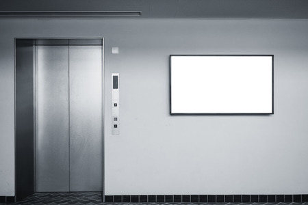 Blank screen sign on wall Indoor Building with elevator
