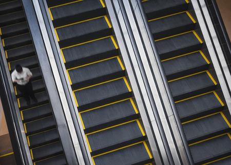Escalators with People standing Indoor Building Banco de Imagens