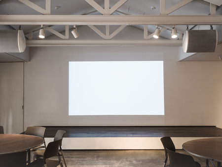 Mock up Screen in Meeting room with table and seats Business presentation