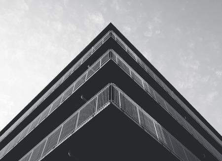 Architecture detail Modern building Facade Corner Black and White