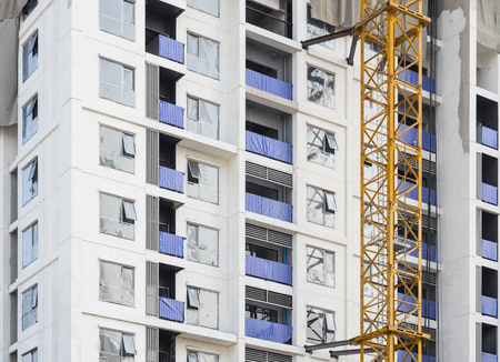 Building exterior with crane construction Industry Architecture details