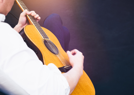 Man play Acoustic Guitar Concert