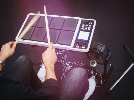 Drummer play electric drum digital drum music instrument