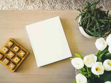 Blank Book cover on table with floral plant Home decoration