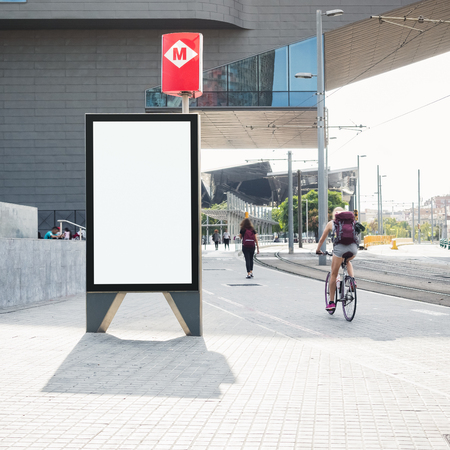 Mock up Banner stand Media outdoor people walking riding bicycle on City street Metro signage Foto de archivo
