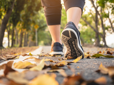 Woman walk in park outdoor Trail exercise healthy lifestyle