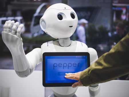 TOKYO, JAPAN - APR 16, 2018 : Pepper Robot Humanoid Assistant with Information screen in Softbank shop Japan