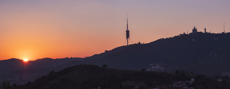 Tibidabo mountain silhoutte landmark Sunset view Barcelona Spain