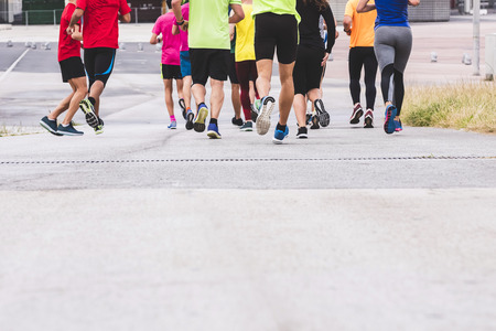 Marathon runners People Race to finish line Outdoor sport training exercise