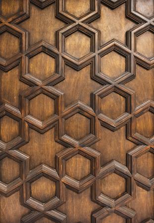 Sculpture de porte en bois motif géométrique ornement décoratif texture background