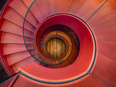 Spiral staircase Modern Architecture detail Red colour Abstract Background Фото со стока