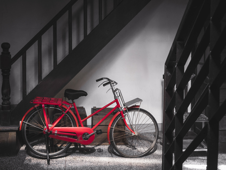 Vintage red bicycle park indoor old house transportation collection Stock Photo