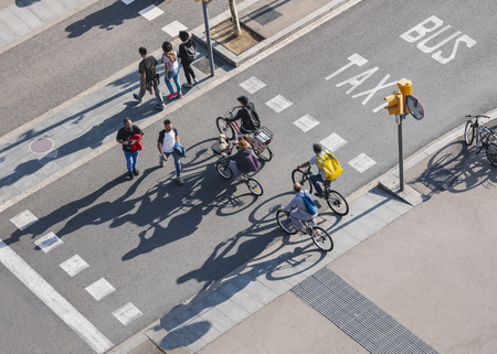 People crossing street Cycling and Walking Traffic sign Smart city Urban lifestyle outdoor