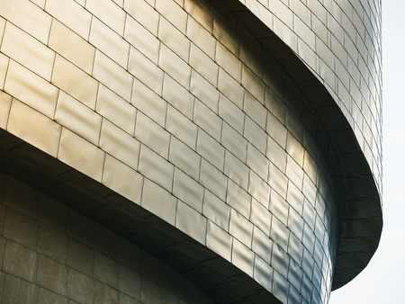 Architecture details Modern building Futuristic Metal wall tiles facade Curve and space
