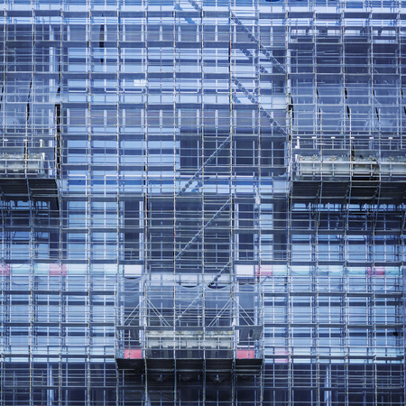 Glass Facade Building Construction industry with scaffold Architecture detail background