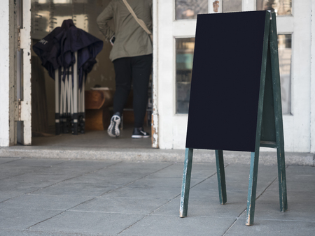 Mock up Blank Chalkboard stand Front shop Signage with customer walking