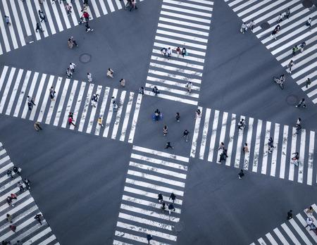 People walking Crossing street Sign Top view Crosswalk in city