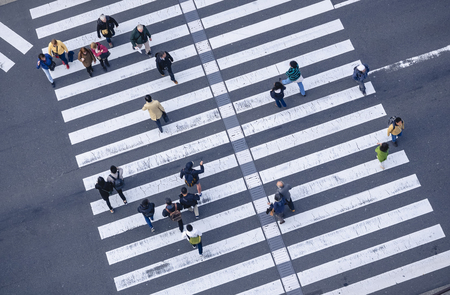 People walking Crossing street Sign Top view Crosswalk in city Business area