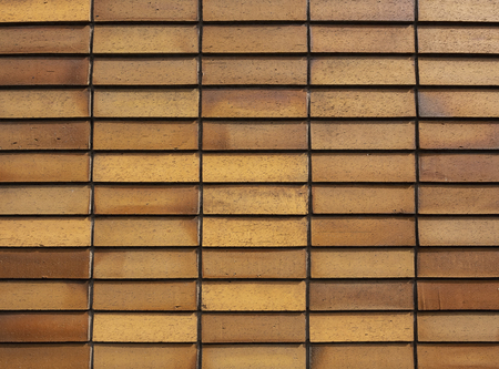 Wall tiles pattern Brown square brick texture Architecture details Abstract background