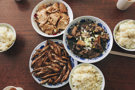 Chinese food local meal tofu fried fish meat with rice Home cook style Table top view Reklamní fotografie