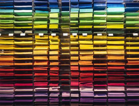Colourful paper on shelf Stationary shop letter paper and envelope Reklamní fotografie