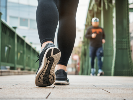Woman walking morning exercise in city Healthy lifestyle Reklamní fotografie