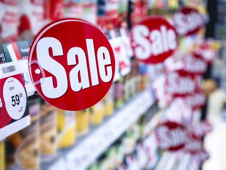 Sale signage Supermarket shelf Marketing Promotion Discount sign in supermarket Retail Business Banco de Imagens